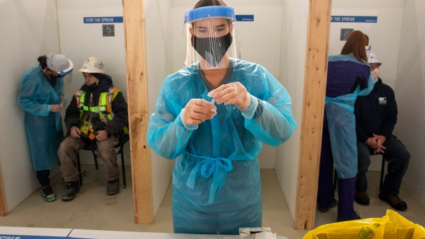 Nurses administer rapid COVID-19 tests at a construction site in Toronto on Thursday, February 18, 2021 THE CANADIAN PRESS/Frank Gunn