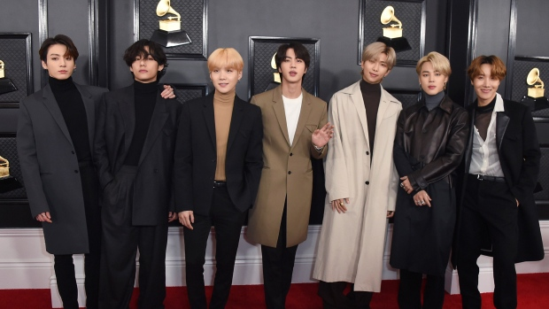 FILE - BTS arrives at the 62nd annual Grammy Awards in Los Angeles on Jan. 26, 2020. The popular band will perfrom at this month's Grammy Awards. (Photo by Jordan Strauss/Invision/AP, File)