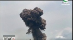 This TVGE image made from video shows smoke rising over the blast site at a military barracks in Bata, Equatorial Guinea, Sunday, March 7, 2021. A series of explosions killed at least 20 people and wounded more than 600 others on Sunday, authorities said. (TVGE via AP)