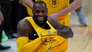 Los Angeles Lakers forward LeBron James walks onto the court for the first half of basketball's NBA All-Star Game in Atlanta, Sunday, March 7, 2021. (AP Photo/Brynn Anderson)