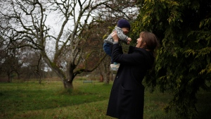 New mother Madeleine Shaw shares a moment with her son George Shaw-Macdonald while at Beacon Hill Park in Victoria, B.C., on Friday, December 18, 2020. THE CANADIAN PRESS/Chad Hipolito