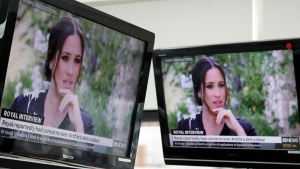 Australian television news in Sydney, Monday, March 8, 2021, reports on an interview of The Duke and Duchess of Sussex by Oprah Winfrey. (AP Photo/Rick Rycroft)