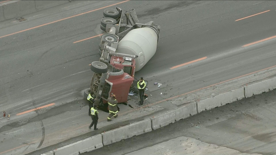 Crews respond to a cement truck rollover on Highway 400 near Lloydtown-Aurora Road Monday March 8, 2021.