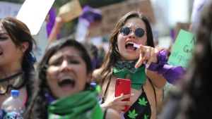 Women protest during a march to commemorate International Women's Day and protest against gender violence, in Mexico City, Monday, March 8, 2021. (AP Photo/Ginnette Riquelme)