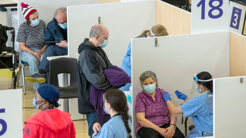 Eligible recipients get their COVID-19 vaccines at a mass vaccination clinic in Toronto on Monday, March 8, 2021. THE CANADIAN PRESS/Frank Gunn