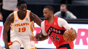 Toronto Raptors' Norman Powell (24) drives past Atlanta Hawks' Tony Snell during the first half of an NBA basketball game Thursday, March 11, 2021, in Tampa, Fla. (AP Photo/Mike Carlson)