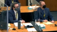 In this image taken from video, defense attorney Eric Nelson, left, and defendant, former Minneapolis police officer Derek Chauvin, right, listen to Hennepin County Judge Peter Cahill during pretrial motions, prior to continuing jury selection in the trial of Chauvin, Thursday, March 11, 2021, at the Hennepin County Courthouse in Minneapolis, Minn. Chauvin is accused in the May 25, 2020, death of George Floyd.  (Court TV/Pool via Pool)