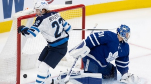 Winnipeg Jets centre Mason Appleton (22) scores on Toronto Maple Leafs goaltender Frederik Andersen (31) during second period NHL action in Toronto on Saturday, March 13, 2021. THE CANADIAN PRESS/Frank Gunn