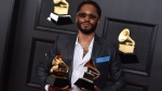 Kaytranada poses in the press room with the award for best dance recording and dance electronic album, for Bubba, at the 63rd annual Grammy Awards at the Los Angeles Convention Center on Sunday, March 14, 2021. (Photo by Jordan Strauss/Invision/AP)