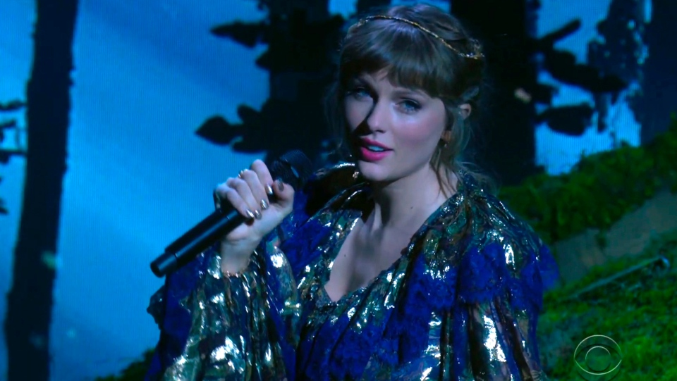 In this video grab provided by CBS and the Recording Academy, Taylor Swift performs a medley at the 63rd annual Grammy Awards at the Los Angeles Convention Center on Sunday, March 14, 2021. (CBS/Recording Academy via AP)
