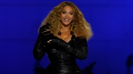 """Beyonce accepts the award for best R&B performance for """"Black Parade"""" at the 63rd annual Grammy Awards at the Los Angeles Convention Center on Sunday, March 14, 2021. (AP Photo/Chris Pizzello)"""