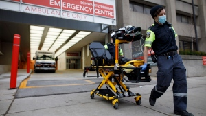 Paramedics wheel a gurney out from the emergency department at Mount Sinai Hospital in Toronto, Wednesday, Jan. 13, 2021. THE CANADIAN PRESS/Cole Burston