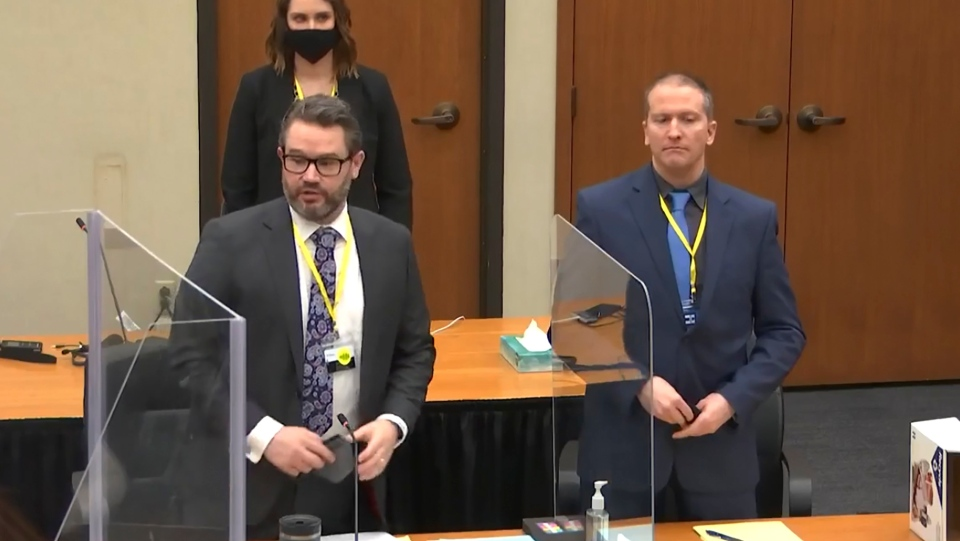 In this image taken from video, defense attorney Eric Nelson, left, and defendant former Minneapolis police officer Derek Chauvin, right, and Nelson's assistant Amy Voss, back, introduce themselves to potential jurors as Hennepin County Judge Peter Cahill presides, prior to continuing jury selection, Monday, March 15, 2021. (Court TV, Pool via AP)