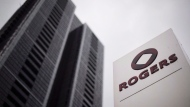 A Rogers Communications Inc. logo is shown outside the Rogers Building in Toronto on Tuesday, April 22, 2014. THE CANADIAN PRESS/Darren Calabrese