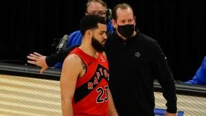 Toronto Raptors head coach Nick Nurse talks to Fred VanVleet during the first half of an NBA basketball game against the Milwaukee Bucks Thursday, Feb. 18, 2021, in Milwaukee. (AP Photo/Morry Gash)