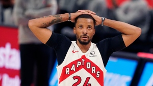 Toronto Raptors guard Norman Powell looks towards the scoreboard during the second half of an NBA basketball game against the Detroit Pistons, Wednesday, March 17, 2021, in Detroit. (AP Photo/Carlos Osorio)
