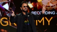 Ringo Starr gestures as he presents the award for record of the year at the 63rd annual Grammy Awards at the Los Angeles Convention Center on Sunday, March 14, 2021. (AP Photo/Chris Pizzello)