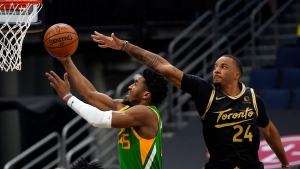 Utah Jazz guard Donovan Mitchell (45) goes to the basket after getting around Toronto Raptors forward Norman Powell (24) during the first half of an NBA basketball game Friday, March 19, 2021, in Tampa, Fla. (AP Photo/Chris O'Meara)