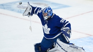Toronto Maple Leafs goaltender Jack Campbell (36) makes a blocker save against the Calgary Flames during first period NHL hockey action in Toronto on Saturday, March 20, 2021. THE CANADIAN PRESS/Nathan Denette