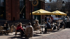 Customers sit on a patio at a coffee shop in the Distillery district in Toronto, Saturday, March 20, 2021. Starting today, restaurants in Toronto and Peel Region can offer customers outdoor dining. THE CANADIAN PRESS/Chris Young