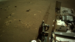 This Mar. 7, 2021 photo provided by NASA shows tire tracks left by the Mars Perseverance rover. The rover has sent back the first-ever sounds of driving on the red planet. The grinding, clanking, banging noises are part of a 16-minute raw audio feed released Wednesday, March 17, 2021 by the Jet Propulsion Laboratory (NASA/JPL-Caltech via AP)