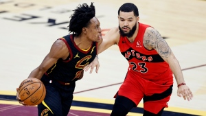 Cleveland Cavaliers' Collin Sexton (2) drives on Toronto Raptors' Fred VanVleet (23) in the first half of an NBA basketball game, Sunday, March 21, 2021, in Cleveland. (AP Photo/Ron Schwane)
