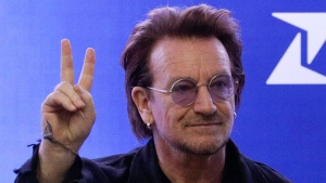 U2 singer Bono gestures as he attends the launching of the first blood by drone delivery service in the country at the Philippine Red Cross headquarters in suburban Mandaluyong, east of Manila, Philippines on Tuesday Dec. 10, 2019. (AP Photo/Aaron Favila)