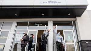 People arrive at the City of Toronto operated mass COVID-19 vaccination site in East York Town Centre, servicing the Thorncliffe Park community on Wednesday, March 24, 2021. THE CANADIAN PRESS/Cole Burston