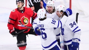 Toronto Maple Leafs' Justin Holl (3) celebrates his game winning goal against the Ottawa Senators with teammate Mitchell Marner (16) and Auston Matthews (34) during overtime NHL action in Ottawa on Thursday, March 25, 2021. THE CANADIAN PRESS/Sean Kilpatrick