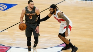 Chicago Bulls guard Zach LaVine, left, drives as he looks to pass against Toronto Raptors forward DeAndre' Bembry during the first half of an NBA basketball game in Chicago, Sunday, March 14, 2021. (AP Photo/Nam Y. Huh)