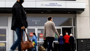 People arrive at the City of Toronto operated mass COVID-19 vaccination site in East York Town Centre, servicing the Thorncliffe Park community, an area disproportionally impacted by COVID-19, Wednesday, March 24, 2021. THE CANADIAN PRESS/Cole Burston