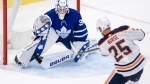 Edmonton Oilers defenceman Darnell Nurse (25) scores the game winning goal on Toronto Maple Leafs goaltender Michael Hutchinson (30) during overtime NHL action in Toronto on Monday March 29, 2021 THE CANADIAN PRESS/Frank Gunn