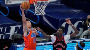 Oklahoma City Thunder center Isaiah Roby (22) shoots in front of Toronto Raptors forward Chris Boucher (25) in the second half of an NBA basketball game Wednesday, March 31, 2021, in Oklahoma City. (AP Photo/Sue Ogrocki)