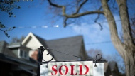 A real estate sold sign is shown in a Toronto west end neighbourhood May 17, 2020. THE CANADIAN PRESS/Graeme Roy