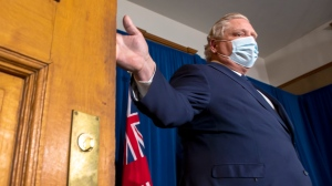 Ontario Premier Doug Ford arrives to make an announcement during the daily briefing at Queen's Park in Toronto on Thursday April 1, 2021.THE CANADIAN PRESS/Frank Gunn
