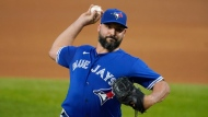Toronto Blue Jays starting pitcher Tanner Roark throws to a Texas Rangers batter during the first inning of a baseball game in Arlington, Texas, Tuesday, April 6, 2021. (AP Photo/Tony Gutierrez)