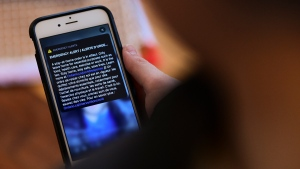 An emergency alert regarding the province's stay-at-home order during the COVID-19 pandemic is viewed on a cell phone in Eastern Ontario on Thursday, Jan. 14, 2021.  THE CANADIAN PRESS/Sean Kilpatrick
