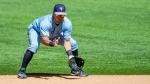 Toronto Blue Jays second baseman Joe Panik (2) fields a hit by Texas Rangers' Nick Solak (15) during the sixth inning of a baseball game, Wednesday, April 7, 2021, in Arlington, Texas. Texas won 2-1. (AP Photo/Brandon Wade)