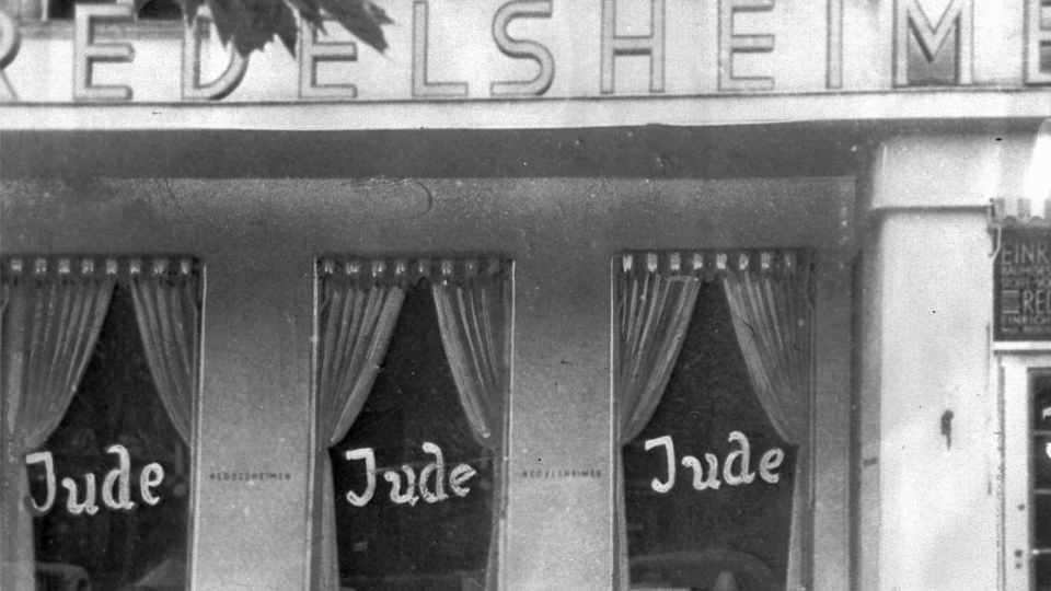 In this June 19, 1938 file picture, the word Jude (jew) is smeared to the windows of a shop in Berlin run by Jews. On Nov. 9, 1938 Nazi-incited mass riots left more than 91 jews dead, damaged more than 1,000 synagogues and left some 7,500 Jewish businesses ransacked and looted. Before local anti-Jewish laws were enacted, before neighborhood shops and synagogues were destroyed, and before Jews were forced into ghettos, cattle cars, and camps, words were used to stoke the fire of hate. 'ItStartedWithWords' is a digital, Holocaust education campaign posting weekly videos of survivors from across the world reflecting on those moments that led up to the Holocaust. (AP Photo, file)