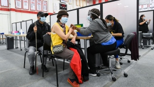 A woman receives her COVID-19 vaccine at the Seneca College mass vaccination site during the COVID-19 pandemic in Toronto on Tuesday, April 6, 2021. THE CANADIAN PRESS/Nathan Denette