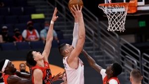Chicago Bulls center Nikola Vucevic (9) shoots against the Toronto Raptors during the second half of an NBA basketball game Thursday, April 8, 2021, in Tampa, Fla. (AP Photo/Jason Behnken)