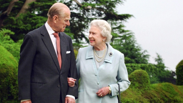 In this Nov. 18, 2007 file photo, Queen Elizabeth II and the Duke of Edinburgh at Broadlands. Prince Philip, the irascible and tough-minded husband of Queen Elizabeth II who spent more than seven decades supporting his wife in a role that both defined and constricted his life, has died, Buckingham Palace said Friday, April 9, 2021. He was 99. (Fiona Hanson/PA via AP, File)
