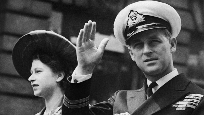 In this June 8, 1948 file photo, the Duke of Edinburgh seated beside Princess Elizabeth, acknowledges the cheers of the crowd as the open Landau passes through Fleet Street on way to the Guildhall in London. Buckingham Palace officials say Prince Philip, the husband of Queen Elizabeth II, has died, it was announced on Friday, April 9, 2021. He was 99. Philip spent a month in hospital earlier this year before being released on March 16 to return to Windsor Castle. Philip, also known as the Duke of Edinburgh, married Elizabeth in 1947 and was the longest-serving consort in British history. (AP Photo/File)