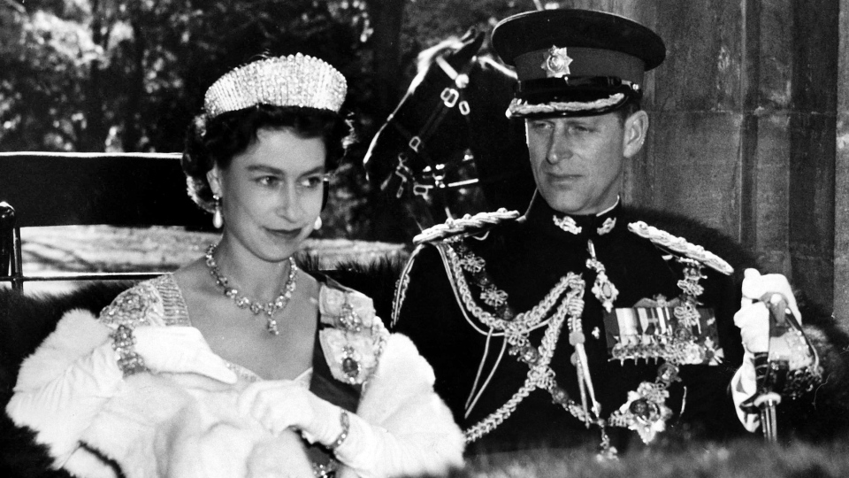 The Queen in her Coronation gown and Prince Philip in the uniform of a Colonel-in-chief of the Royal Canadian Regiment present a royal picture as they drive in an open carriage to open Parliament in Ottawa on October 14, 1957.Prince Philip, the Queen's husband of more than 70 years, passed away at Windsor Castle on Friday, Buckingham Palace announced. THE CANADIAN PRESS/AP