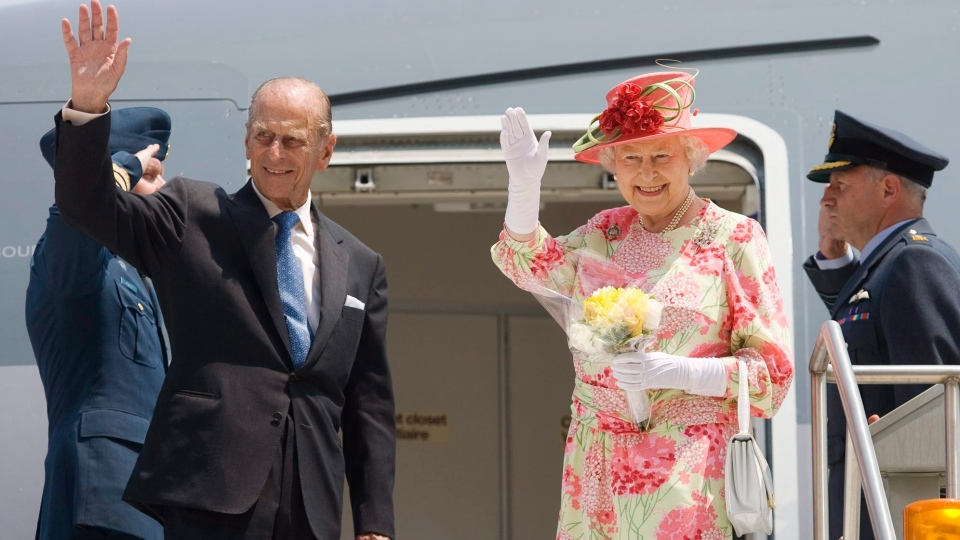 The Queen and Prince Philip wave goodbye as they board their plane to New York at Pearson International Airport in Toronto on July 6, 2010. Prince Philip, the Queen's husband of more than 70 years, passed away at Windsor Castle on Friday, Buckingham Palace announced.THE CANADIAN PRESS/Darren Calabrese