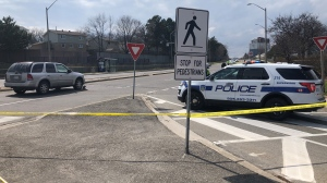 Peel police respond to the scene where a young child was struck by a vehicle in Mississauga Friday, April 9, 2021. (Corey Baird)