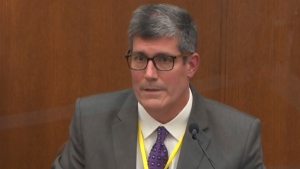 In this image from video, Dr. Andrew Baker, Hennepin County Medical Examiner, testifies as Hennepin County Judge Peter Cahill presides Friday, April 9, 2021, in the trial of former Minneapolis police Officer Derek Chauvin at the Hennepin County Courthouse in Minneapolis, Minn. Chauvin is charged in the May 25, 2020 death of George Floyd. (Court TV via AP, Pool)