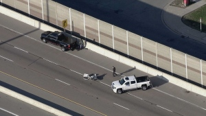 Police are investigating a motorcycle crash on Highway 427. (Chopper 24)