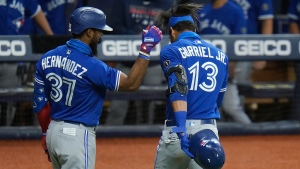 Toronto Blue Jays' Lourdes Gurriel Jr. (13) celebrates his solo home run off Tampa Bay Rays starting pitcher Blake Snell with Teoscar Hernandez during the sixth inning of a baseball game Monday, Aug. 24, 2020, in St. Petersburg, Fla. (AP Photo/Chris O'Meara)