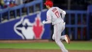 Los Angeles Angels' Shohei Ohtani runs the bases after his solo home run against the Toronto Blue Jays during the fifth inning of a baseball game Friday, April 9, 2021, in Dunedin, Fla. (AP Photo/Mike Carlson)